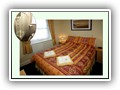 (Room 5) A double room located at the rear of the property on the first floor with full en-suite shoer room.